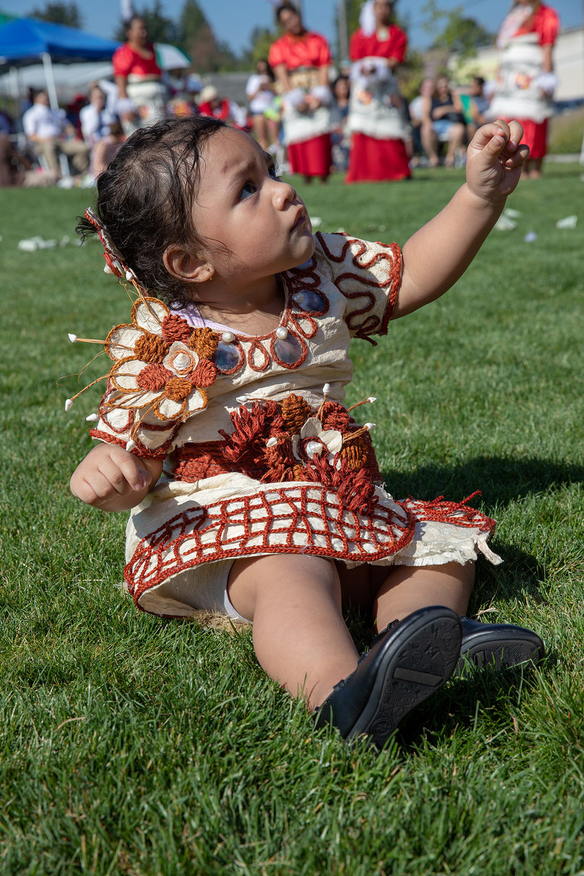 Young toddler girl celebrating at Tonga Day festival