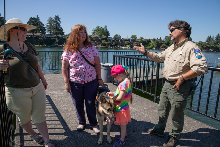Patricia Kepler talks to Park Ranger Jim Caudell at Blue Lake Regional Park
