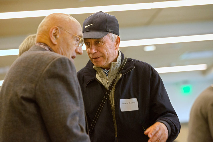 two elderly men talking