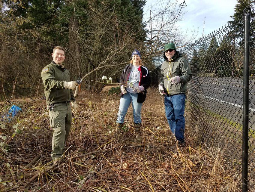 Three volunteers clean up Glendoveer Fitness trail