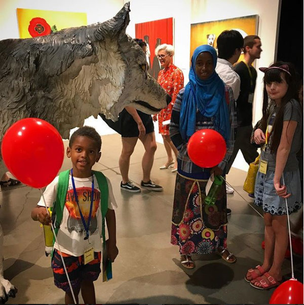 kids with red balloons at Kings School Museum of Contemporary Art 2016 International Art Fair