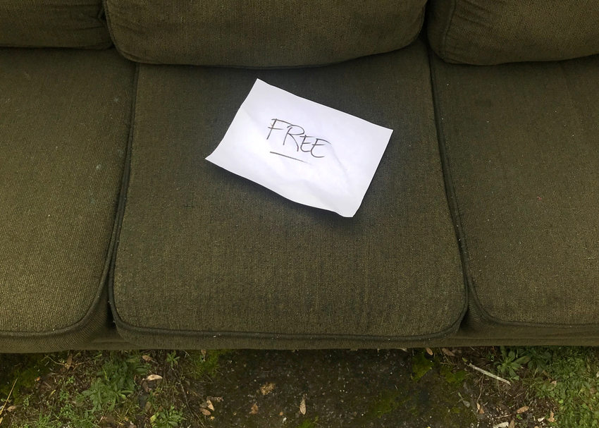 free sign on a curbside sofa