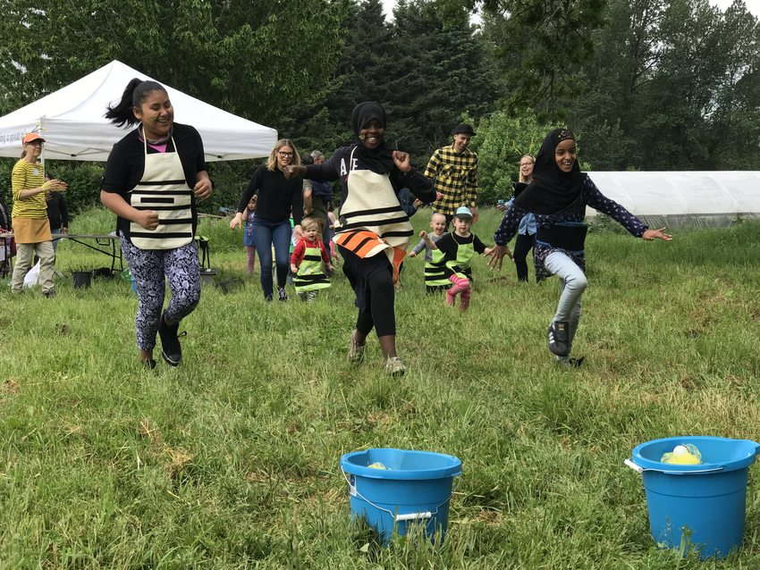 3 girls race at the Pollinator Picnic