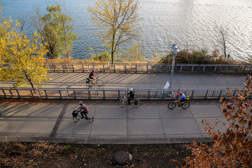 Cyclists bike on the East Bank Esplanade in Portland, Ore.
