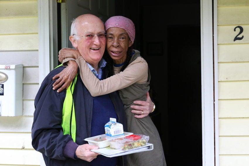 Meals on Wheels People volunteer being hugged for their service