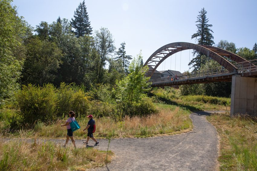 Two people walking on a trail in Orenco Woods Nature Park