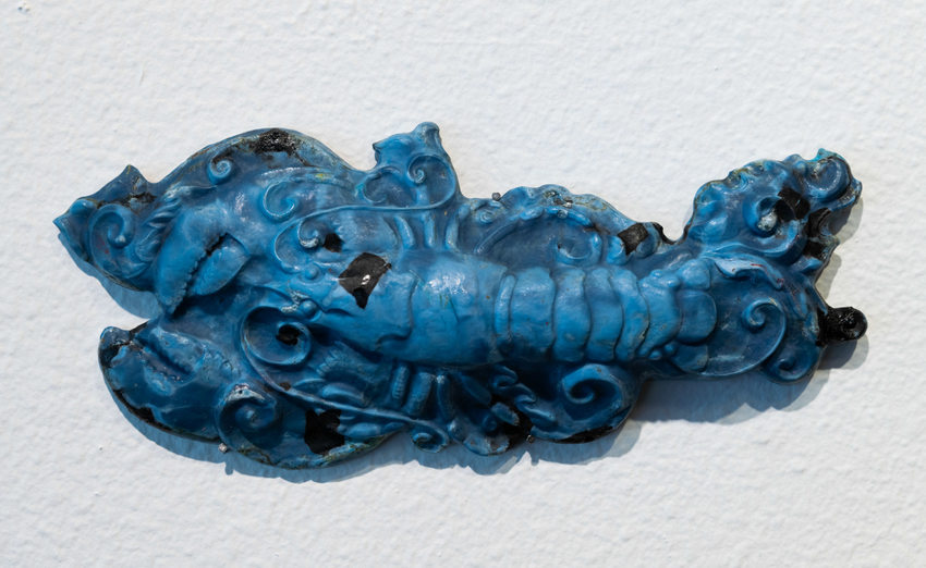 detail of blue plastic lobster