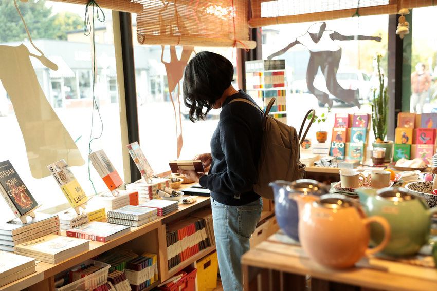 A woman browses through the offerings at a local gift shop