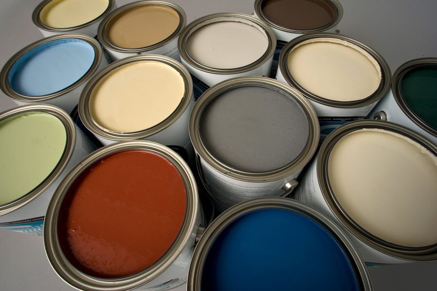 opened gallon cans of Metro paint in a variety of colors
