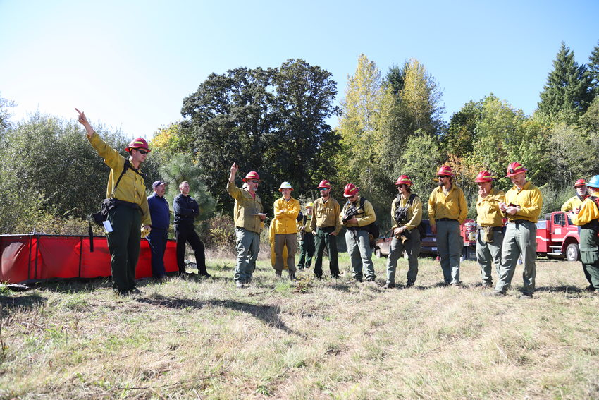 photo of fire crews preparing for a prescribed burn at Quamash Prairie