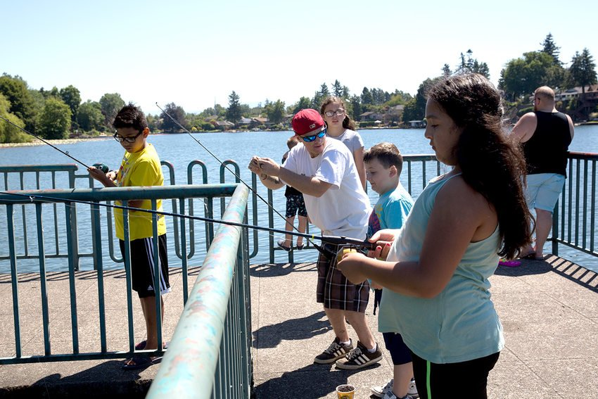 A family fishes from the docks at Blue Lake Regional Park.