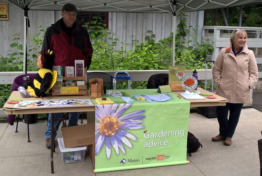 master gardeners providing garden education at table at Oregon Zoo