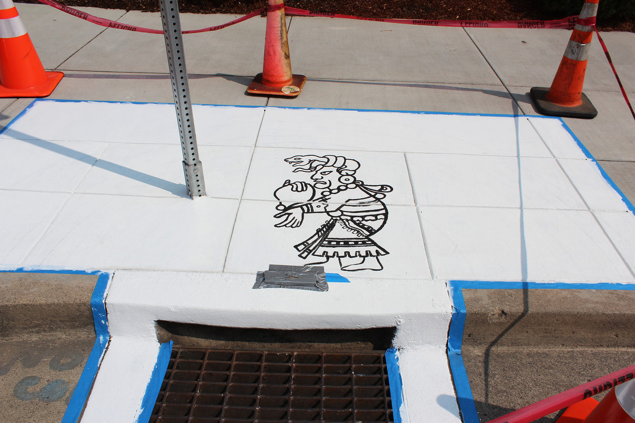 The Mayan rain god Chac is outlined on a mural in Hillsboro