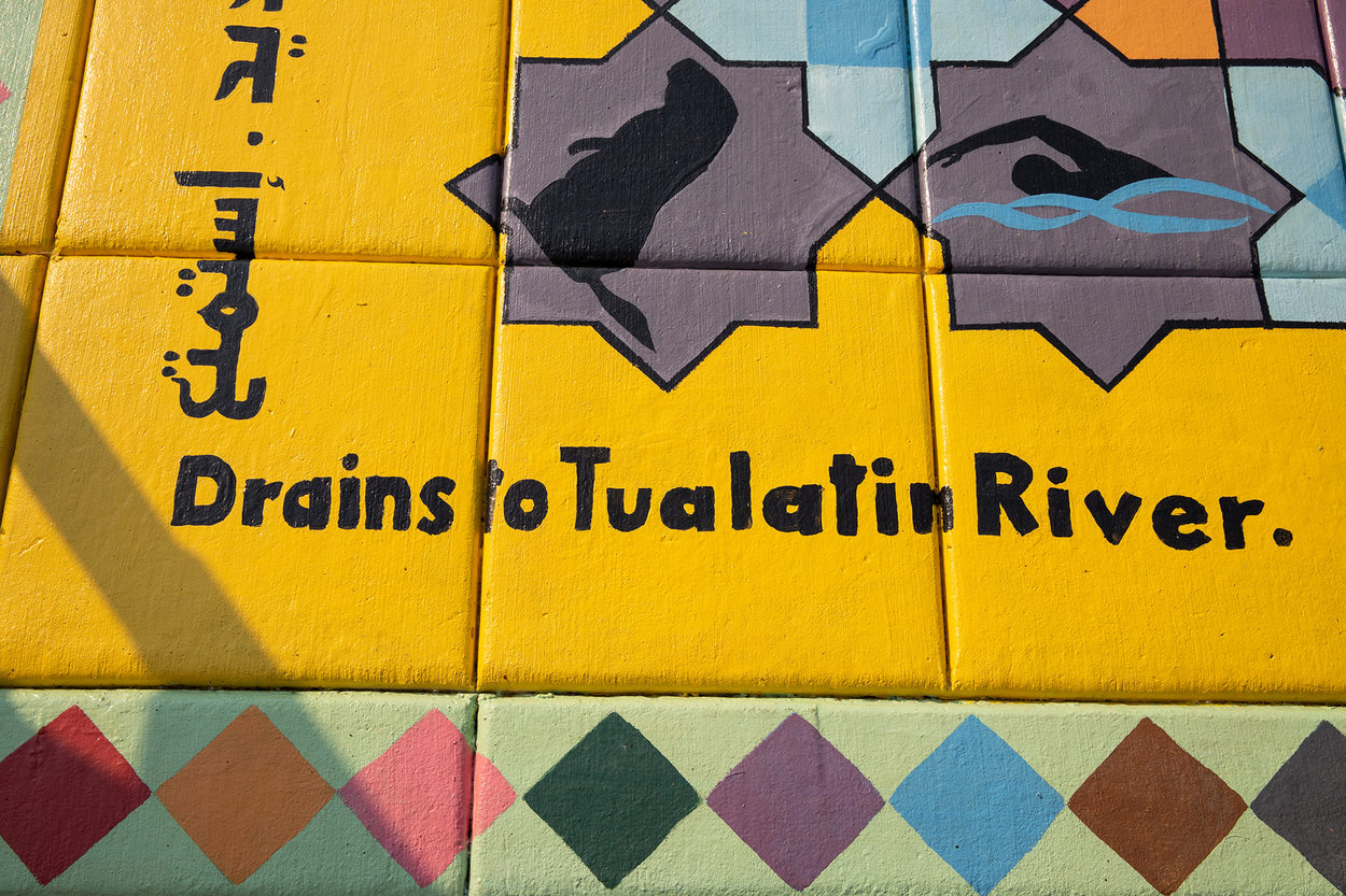 "A placemaking mural has a message that says ""drains to Tualatin River"""