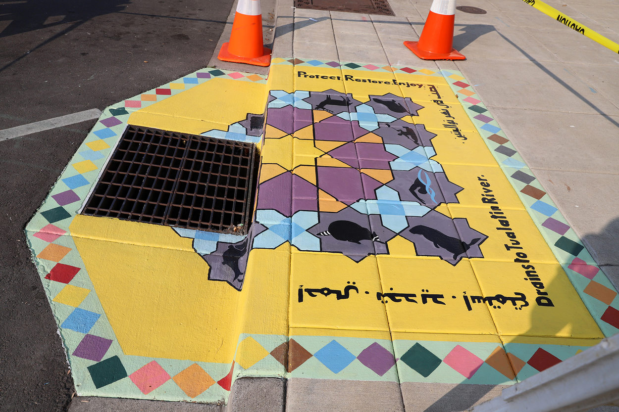 A placemaking mural on the sidewalk in Tigard