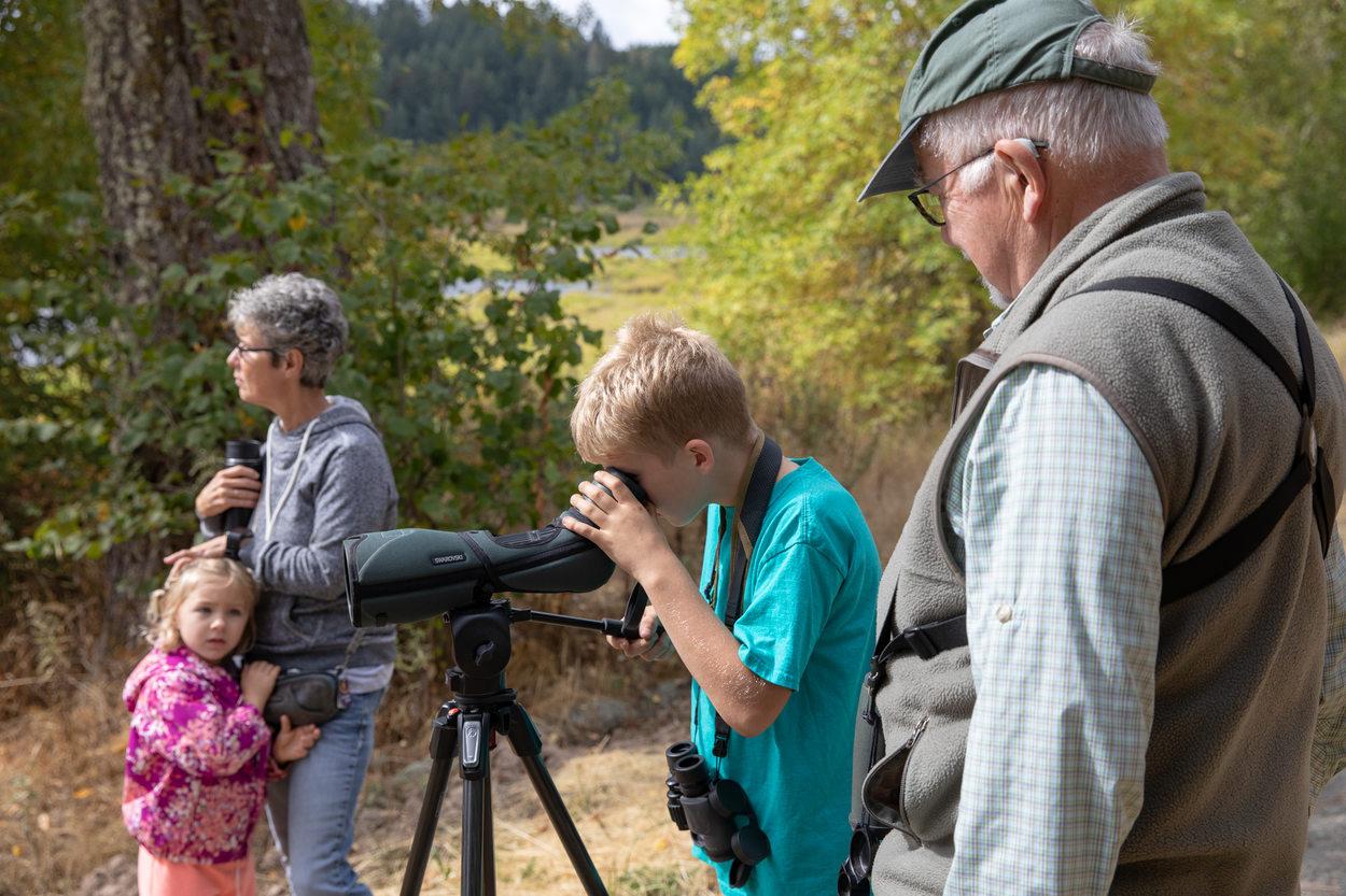 Dorman Moehnke, 9, looks at a mallard through a telescope at Killin Wetlands Nature Park.