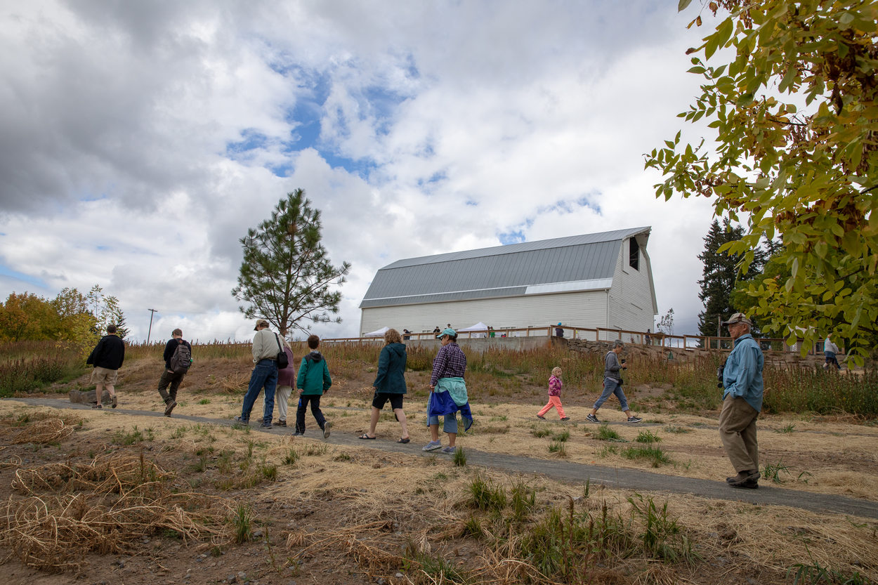 Visitors walk along a trail, making their way back to the entrance area of Killin Wetlands Nature Park.