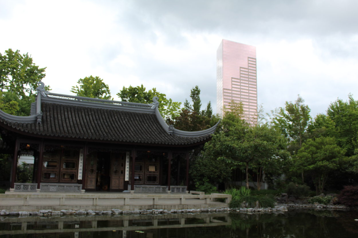 "The U.S. Bancorp Tower, known as ""Big Pink,"" stands tall in the background from a view at the Lan Su Chinese Garden"