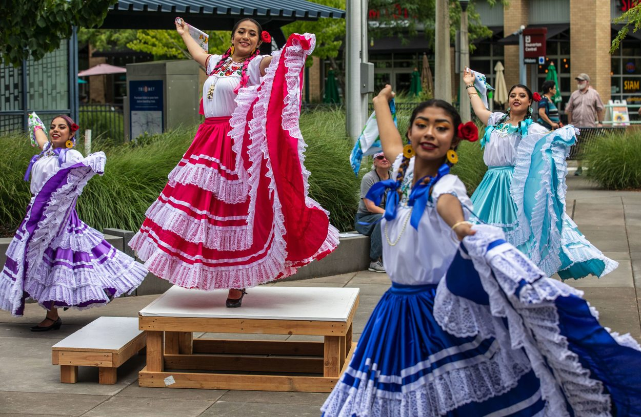 Young girls in a ballet folklorico troupe dance during a performance