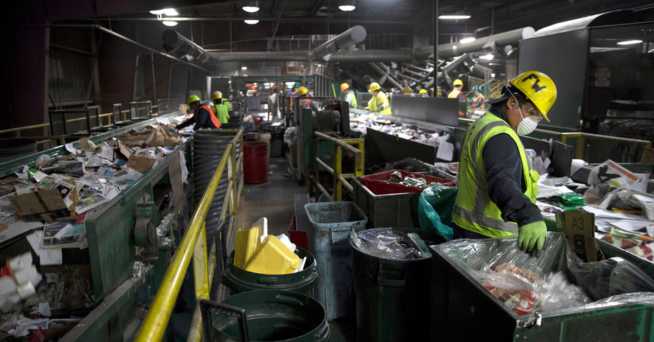 recycling facility workers sort items