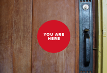 You are here logo with door knob