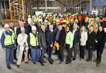 Metro staff and councilors gather with construction crew for a group photo to celebrate the topping off of the Hyatt Regency Portland hotel project
