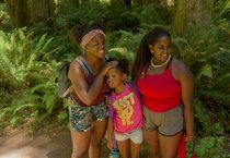 photo of two Camp ELSO guides and one student at Oxbow Regional Park's ancient forest