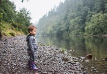 A little child looks out on the Sandy River at Dabney State Park, just outside of Gresham and Troutdale.