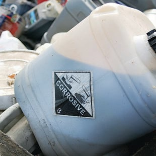 photo of corrosive hazardous waste tub