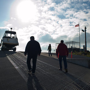 photo of men walking up to a boat at M. James Gleason Boat Ramp