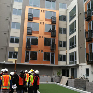 photo of a construction tour at the Prescott Apartments