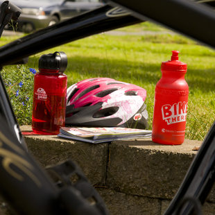 photo of a bike helmet and water bottle
