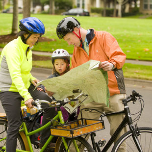 photo of a family reading a bike map