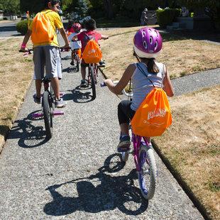 photo of kids on a bike ride