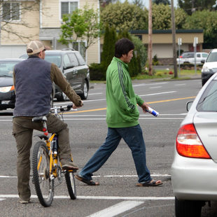 Wide crop of pedestrian, cars, bike at 82nd and Division