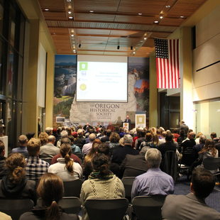 A packed house listens as panelists discuss the past and future of landfills at the Let's Talk Trash event Nov. 4, 2015 at the Oregon Historical Society in Portland.