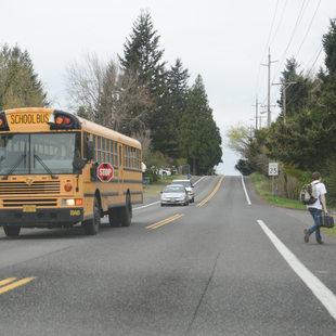 Student getting off school bus in Gresham