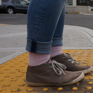 Feet waiting to cross a street