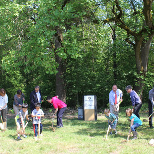Hillsboro and Metro officials and seven Orenco Elementary School students break ground at Orenco Woods.