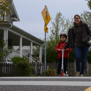 A mother and son cross a crosswalk in Southeast Portland