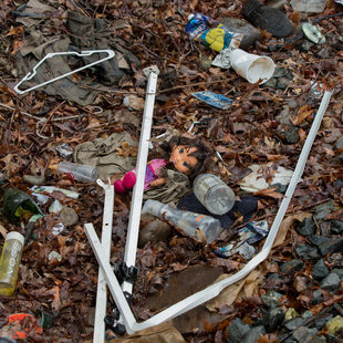 garbage and debris in an area of Sullivan's Gulch in Portland