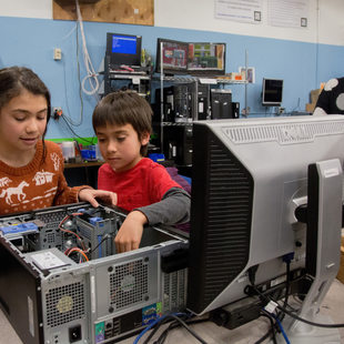 two children learning to build a computer