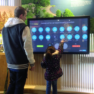 father and son using interactive park finder map at Oregon Zoo Education Center