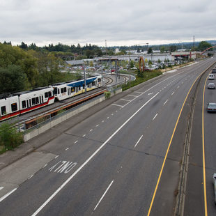 Image of MAX train alongside freeway