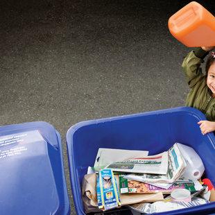 photo of girl recycling orange jug