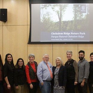 Metro council members and community leaders from Centro Cultural pose for photo following the adoption of the Chehalem Ridge Nature Park master plan