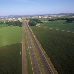 Photo of a highway with farm fields on either side