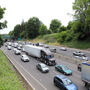 Freight trucks drive on Interstate 5