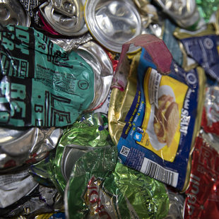 close up of compacted aluminum cans