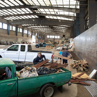 a man unloads construction waste at a transfer station